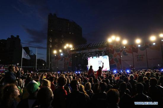 Athletes attend the closing ceremony of the 2018 Summer Youth Olympic Games at the Youth Olympic Village in Buenos Aires, Argentina, on Oct. 18, 2018. (Xinhua/Li Ming)