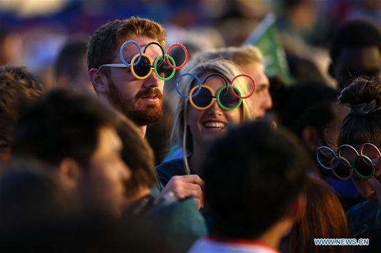 Athletes react before the closing ceremony of the 2018 Summer Youth Olympic Games at the Youth Olympic Village in Buenos Aires, Argentina, on Oct. 18, 2018. (Xinhua/Li Ming)