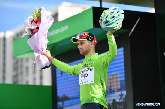 Jakub Mareczko of Italy's Wilier Triestina cycling team wears the green jersey on the podium after the first stage of the 2018 Tour of Hainan International Road Cycling Race in Danzhou, south China's Hainan Province, Oct. 23, 2018. (Xinhua/Guo Cheng)