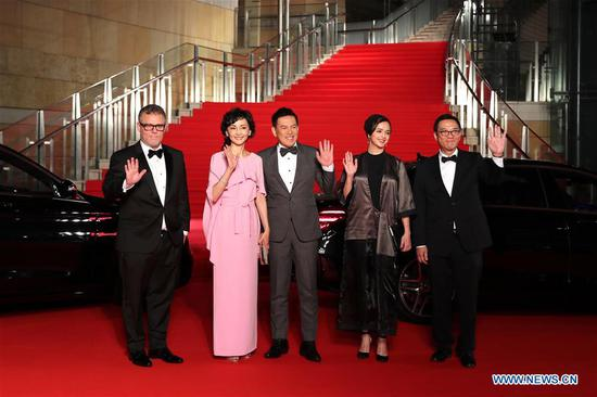 The International Competition Jury wave hands on the red carpet for the opening ceremony of the 31st Tokyo International Film Festival, Tokyo, Japan, Oct. 25, 2018. (Xinhua/Du Xiaoyi)