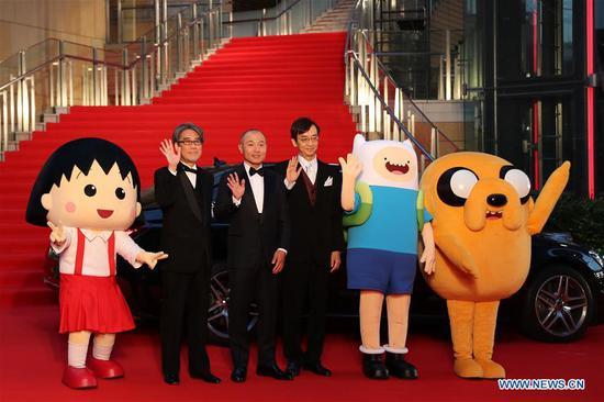 Japanese animation director Masaaki Yuasa (3rd L) with