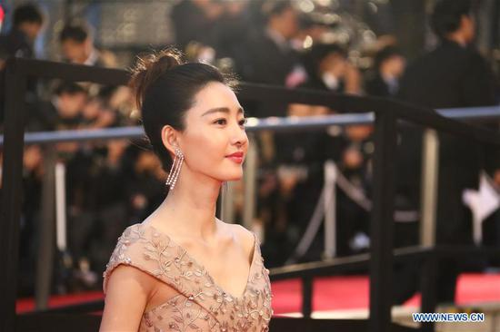 Chinese actress Wang Likun is pictured on the red carpet for the opening ceremony of the 31st Tokyo International Film Festival, Tokyo, Japan, Oct. 25, 2018. (Xinhua/Peng Chun)