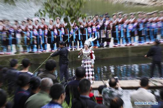 A singer of Miao ethnic group sings during a harvest festival in Dongtou Village, Rongshui Miao Autonomous County, south China's Guangxi Zhuang Autonomous Region, Oct. 26, 2018. Local people celebrated harvest Friday through various activities like fish feast, singing and playing lusheng. (Xinhua/Lan Hongguang)