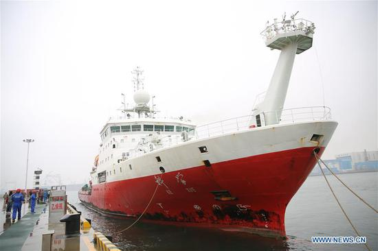 The research vessel Kexue is seen anchored at its home port in the Qingdao West Coast New Area in Qingdao, east China's Shandong Province, Nov. 5, 2018. The research vessel returned to Qingdao on Monday from a 31-day scientific expedition to the West Pacific. (Xinhua/Zhang Jingang)