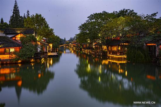 Photo taken on Nov. 6, 2018 shows the night scenery of Wuzhen International Internet Exhibition and Convention Center, a permanent home for the World Internet Conference, in Wuzhen, east China's Zhejiang Province. The fifth World Internet Conference (WIC) is scheduled to run from November 7-9 in the river town of Wuzhen. (Xinhua/Xu Yu)