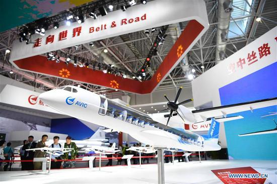 A model of the Xinzhou-700 turboprop passenger aircraft is displayed at the exhibition booth of the Aviation Industry Corporation of China (AVIC) during the 12th China International Aviation and Aerospace Exhibition (Airshow China) in Zhuhai, south China's Guangdong Province, Nov. 6, 2018. Opening Tuesday in Zhuhai, the airshow runs until Nov. 11 and is attended by over 700 exhibitors from 40 countries and regions. (Xinhua/Deng Hua)