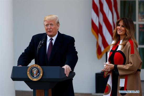 U.S. President Donald Trump (L) speaks during the National Thanksgiving Turkey Pardoning Ceremony at the Rose Garden of the White House in Washington D.C., the United States, on Nov. 20, 2018. (Xinhua/Ting Shen)