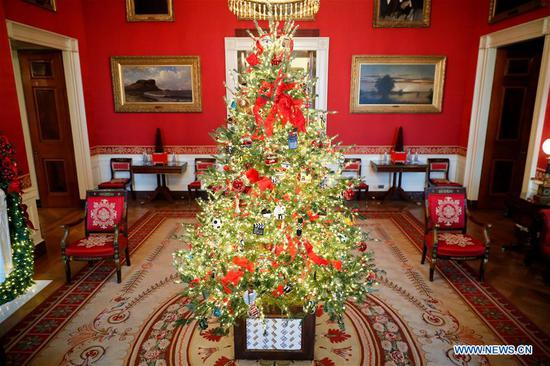 The Red Room is seen decorated for Christmas during the 2018 Christmas Press Preview at the White House in Washington D.C., the United States on Nov. 26, 2018. (Xinhua/Ting Shen)