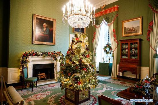 The Green Room is seen decorated for Christmas during the 2018 Christmas Press Preview at the White House in Washington D.C., the United States, on Nov. 26, 2018. (Xinhua/Ting Shen)