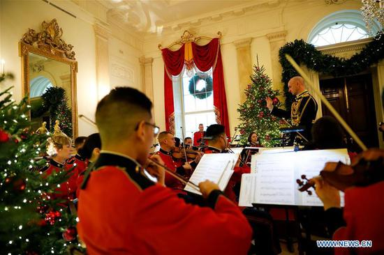 The United States Marine Band performs in the Grand Foyer of the White House during the 2018 Christmas Press Preview in Washington D.C., the United States, on Nov. 26, 2018. (Xinhua/Ting Shen)