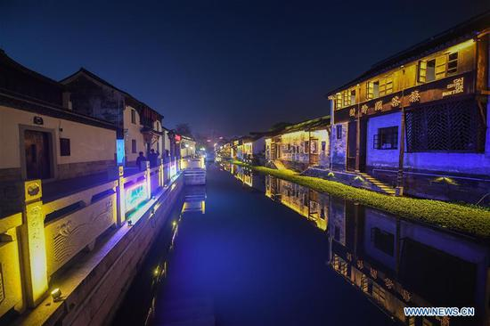 Photo taken on Nov. 28, 2018 shows the night scenery of Xiaoxijie historical and cultural block in Huzhou City, east China's Zhejiang Province. Since 2018, low carbon energy use has been promoted during the management of the Xiaoxijie historical and cultural block. Electrification has been applied and electricity using for cooking is encouraged. (Xinhua/Xu Yu)
