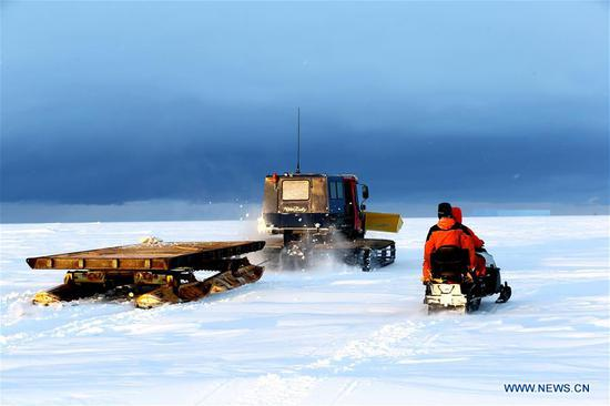 Staff members of the research team drive snowmobiles to detect routes on ice in Antarctica, Nov. 30, 2018. China's research icebreaker Xuelong, also known as the Snow Dragon, is now 44 kilometers away from the Zhongshan station. Unloading operations have been carried out after the routes were determined. (Xinhua/Liu Shiping)