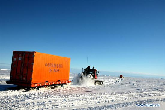 Snowmobiles loaded with supplies head for the Zhongshan station in Antarctica, Dec. 2, 2018. China's research icebreaker Xuelong, also known as the Snow Dragon, is now 44 kilometers away from the Zhongshan station. Unloading operations have been carried out after the routes were determined. (Xinhua/Liu Shiping)