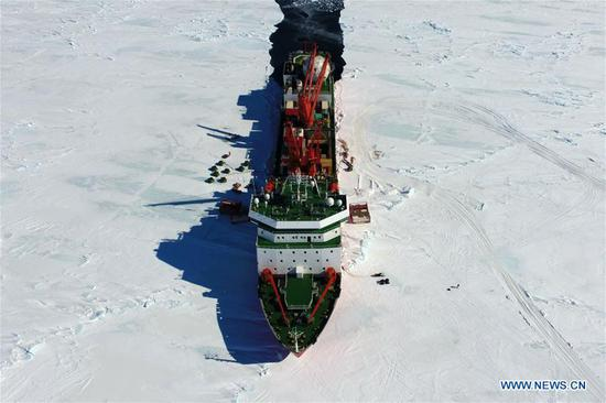 Aerial photo taken on Dec. 3, 2018 shows China's research icebreaker Xuelong in Antarctica. China's research icebreaker Xuelong, also known as the Snow Dragon, is now 44 kilometers away from the Zhongshan station. Unloading operations have been carried out after the routes were determined. (Xinhua/Liu Shiping)