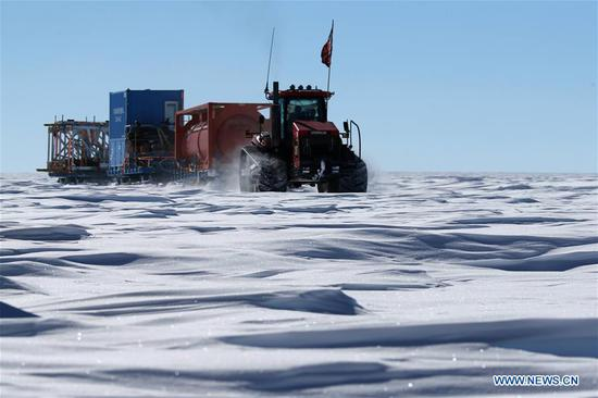 A vehicle of China's 35th Antarctic expedition team runs on Antarctica's inland icecap, Jan. 2, 2019. The expedition team Wednesday entered the area of the Dome Argus (Dome A), the peak of Antarctica's inland icecap. (Xinhua/Liu Shiping)