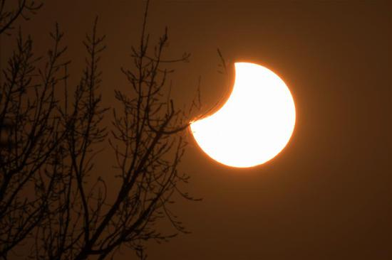 A partial solar eclipse is observed as the moon passes in front of the sun in Beijing, capital of China, Jan. 6, 2019. (Xinhua/Ju Huanzong)