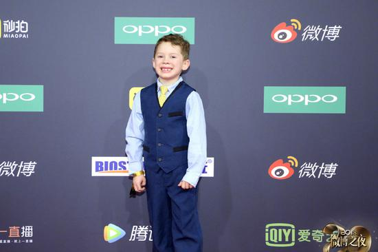 Gavin Thomas poses as he arrives on the red carpet for the 2018 Weibo Night Ceremony in Beijing, China, Jan 11.
