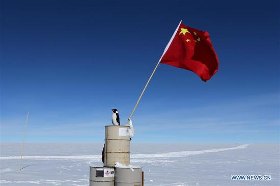 The Chinese national flag is seen at the area of the Dome Argus (Dome A), the peak of Antarctica's inland icecap, in Antarctica, Jan. 16, 2019. (Xinhua/Liu Shiping)