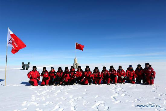 Members of China's 35th Antarctic expedition team pose for a group photo at the area of the Dome Argus (Dome A), the peak of Antarctica's inland icecap, in Antarctica, Jan. 16, 2019. (Xinhua/Liu Shiping)
