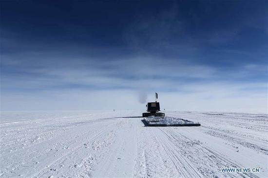 Members of China's 35th Antarctic expedition team level the runway of the airport at the Kunlun Station at about 4,000 meters above the sea level near Dome A, Jan. 17, 2019. Snow Eagle 601 landed successfully at the airport of Kunlun Station on Friday, the third time the aircraft landed successfully in the airport since its use. (Xinhua/Liu Shiping)