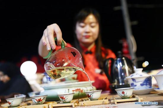 An artist from north China's Shanxi Province performs tea art at a temple fair celebrating the Chinese Spring Festival in Sharm el-Sheikh, Egypt, Jan. 30, 2019. The Egyptian tourism city of Sharm el-Sheikh embraced a large festivity where hundreds of rejoiced Egyptians and Chinese celebrated the Chinese Spring Festival together. The event hosted by the Chinese Embassy in Egypt kicked off Wednesday and will run through Friday. (Xinhua/Ahmed Gomaa)