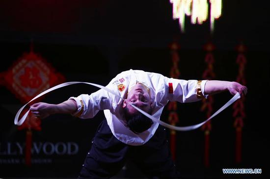 An artist from north China's Shanxi Province performs noodle-making skills at a temple fair celebrating the Chinese Spring Festival in Sharm el-Sheikh, Egypt, Jan. 30, 2019. The Egyptian tourism city of Sharm el-Sheikh embraced a large festivity where hundreds of rejoiced Egyptians and Chinese celebrated the Chinese Spring Festival together. The event hosted by the Chinese Embassy in Egypt kicked off Wednesday and will run through Friday. (Xinhua/Ahmed Gomaa)