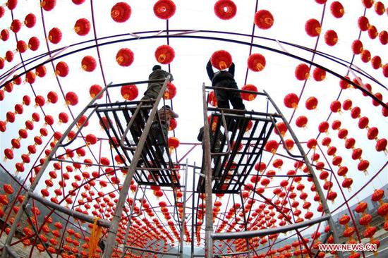 Workers hang red lanterns for the upcoming Spring Festival at Yingtaogou Village in Chadian Township of Shiyan City, central China's Hubei Province, Jan. 31, 2019. The Spring Festival, or the Chinese Lunar New Year, falls on Feb. 5 this year. (Xinhua/Cao Zhonghong)