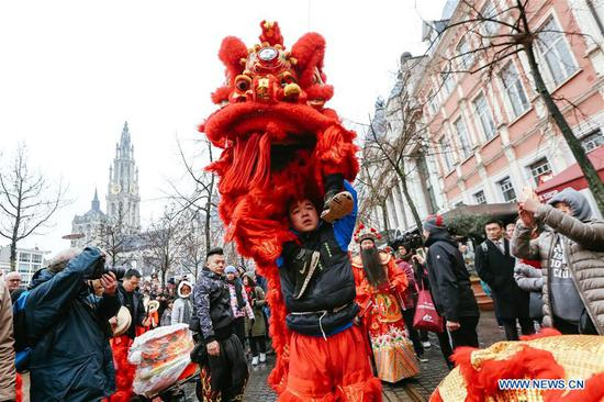 People take part in the 2019 Spring Festival parade in downtown Antwerp, Belgium, on Feb. 2, 2019. A long parade was held in the Belgian city of Antwerp on Saturday as part of the 2019 Spring Festival organized by the local Chinese community and Antwerp to mark the beginning of the Chinese New Year. (Xinhua/Zhang Cheng)
