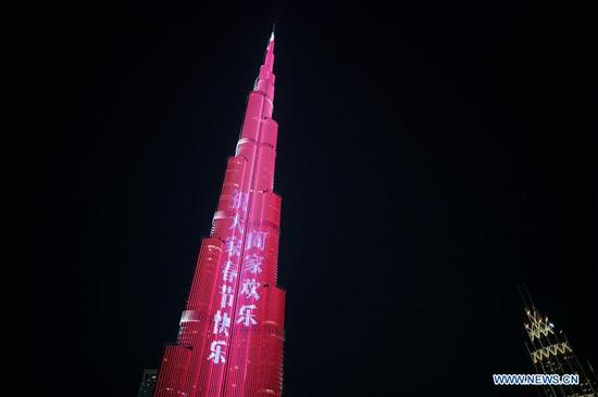 Light show is seen at Burj Khalifa, the world's tallest building, to celebrate the Chinese Lunar New Year in Downtown Dubai, the United Arab Emirates (UAE), Feb. 4, 2019. The Chinese Lunar New Year falls on Feb. 5 this year. (Xinhua/Mahmoud Khaled)
