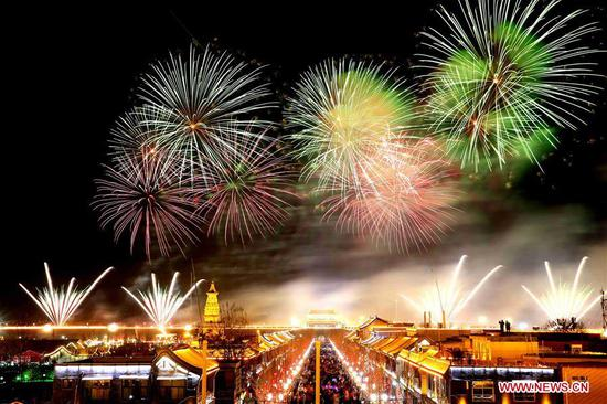 Virtual firework display is seen over Zhengding ancient town in north China's Hebei Province, Feb. 9, 2019. China's domestic tourism revenue gained 513.9 billion yuan (about 76.21 billion U.S. dollars) during the week-long Spring Festival holiday that ends Sunday, an annual increase of 8.2 percent, according to the Ministry of Culture and Tourism. A total of 415 million trips were made across the country during the holiday, rising by 7.6 percent year on year, according to the ministry. Traditional culture was one of the travelers' favorites during the holiday, as a survey by an institution under the ministry showed that about 40 percent of the travelers had visited museums on their trips. During the Spring Festival holiday last year, 386 million trips were made domestically, contributing to an increase of 475 billion yuan in China's travel revenue. (Xinhua/Zhang Haiqiang)