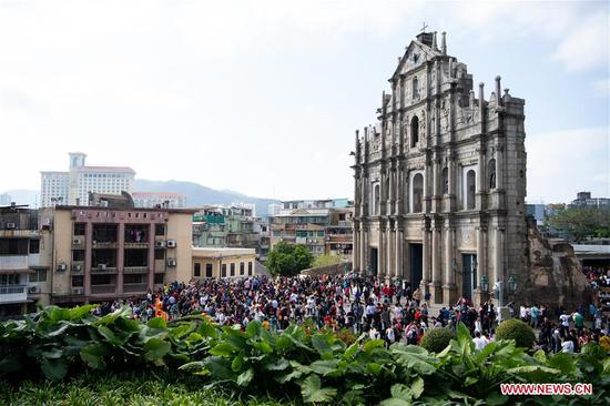 Tourists visit the Ruins of St. Paul's in Macao, south China, Feb. 6, 2019, the second day of the Chinese Lunar New Year. (Xinhua/Cheong Kam Ka)