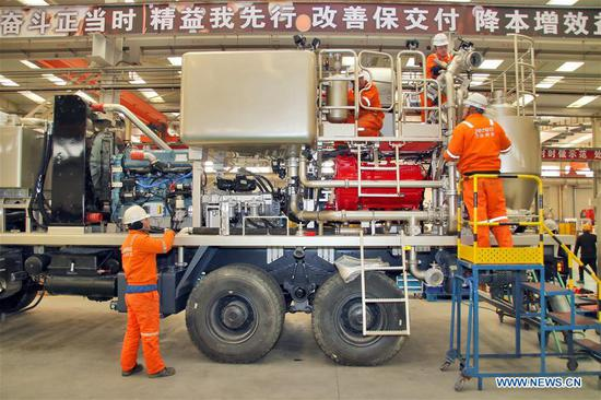 Workers are on duty at a petroleum equipment company in Yantai, east China's Shandong Province, Feb. 11, 2019, the first workday after Spring Festival holiday. Millions of Chinese return to work as the week-long Spring Festival holiday ends. (Xinhua/Tang Ke)