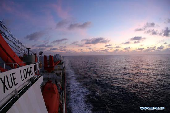 Photo taken on March 5, 2019 shows the evening glow seen from China's research icebreaker Xuelong on the South China Sea. China's research icebreaker Xuelong, carrying members of China's 35th research mission to Antarctica, sailed on the South China Sea on Wednesday and is expected to return to Shanghai six days later. (Xinhua/Liu Shiping)
