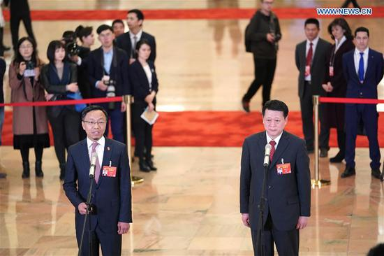 Zhao Jiajun (R) and Lyu Hongbing, members of the 13th National Committee of the Chinese People's Political Consultative Conference (CPPCC), receive an interview ahead of the second plenary meeting of the second session of the 13th CPPCC National Committee at the Great Hall of the People in Beijing, capital of China, March 9, 2019. (Xinhua/Chen Yehua)