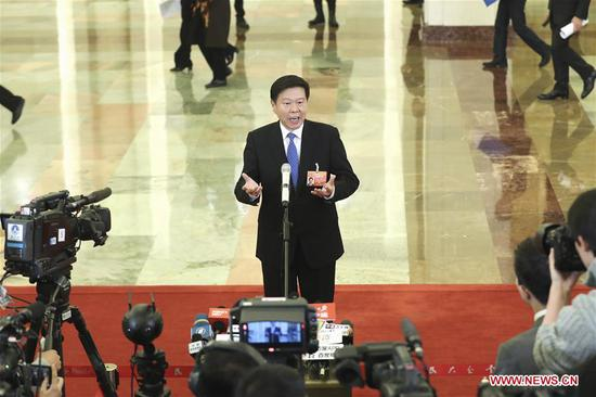 Wang Jun, director of the State Administration of Taxation, receives an interview before the third plenary meeting of the second session of the 13th National People's Congress (NPC) at the Great Hall of the People in Beijing, capital of China, March 12, 2019. (Xinhua/Yin Gang)