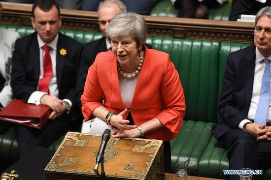 British Prime Minister Theresa May attends the Prime Minister's Questions in the House of Commons in London, Britain, on Feb. 27, 2019. Theresa May promised on Tuesday that the members of parliament (MPs) would be given a choice to vote on no-deal Brexit or delayed departure from the European Union (EU) if her deal is rejected in a meaningful vote in mid-March. (Xinhua/British Parliament/Jessica Taylor)