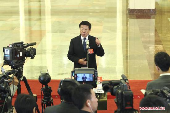 Zhang Jianlong, director of the National Forestry and Grassland Administration, receives an interview before the third plenary meeting of the second session of the 13th National People's Congress (NPC) at the Great Hall of the People in Beijing, capital of China, March 12, 2019. (Xinhua/Yin Gang)