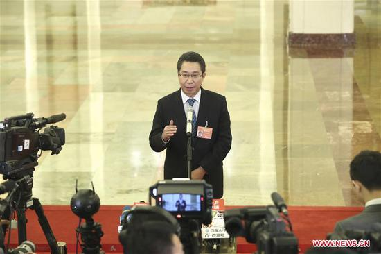 Shen Changyu, head of the State Intellectual Property Office, receives an interview before the third plenary meeting of the second session of the 13th National People's Congress (NPC) at the Great Hall of the People in Beijing, capital of China, March 12, 2019. (Xinhua/Yin Gang)