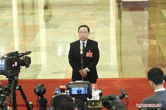 Minister of Justice Fu Zhenghua receives an interview before the third plenary meeting of the second session of the 13th National People's Congress (NPC) at the Great Hall of the People in Beijing, capital of China, March 12, 2019. (Xinhua/Yin Gang)