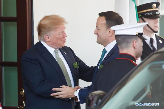 U.S. President Donald Trump (L) welcomes Irish Prime Minister Leo Varadkar (C) at the White House in Washington D.C., the United States, on March 14, 2019. (Xinhua/Ting Shen)