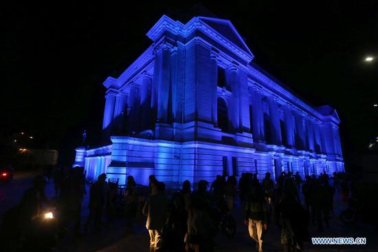 Photo taken on April 2, 2019 shows the Gaddi Baithak Palace illuminated in blue color during an event to call for care for autistic children to mark World Autism Awareness Day at Hanumandhoka Durbar Square in Kathmandu, Nepal. (Xinhua/Sunil Sharma)