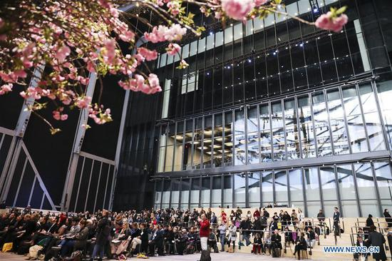 Visitors listen to remarks at the McCourt, a multi-use hall for large-scale performances, installations and events, during a media preview in The Shed, a new arts center in New York, the United States, on April 3, 2019. The Shed, New York City's new arts center that commissions, develops, and presents original works of art, across all disciplines, for all audiences, will open to the public on April 5 with the world premiere of Soundtrack of America. (Xinhua/Wang Ying)