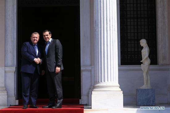 Greek Prime Minister Alexis Tsipras (R) meets with Danish Prime Minister Lars Loekke Rasmussen at the Prime Minister's Office in Athens, Greece, April 4, 2019. (Xinhua/Marios Lolos)