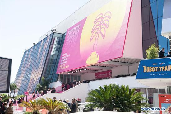 People take part in the 2019 Cannes International Series Festival, or Canneseries 2019, in Cannes, France, April 8, 2019. Many TV series, documents and cartoons presented by Chinese exhibitors drew people's attention during the big event running from 5 to 10 April. (Xinhua/Jack Chan)