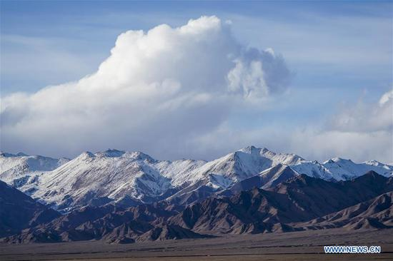 Photo taken on March 30, 2019 shows snow mountains in the Altun Mountains National Nature Reserve in northwest China's Xinjiang Uygur Autonomous Region. Altun Mountain National Nature Reserve saw the number of three rare wild animals reach around 100,000, according to local researchers. The population of wild yak, Tibetan antelope and wild ass is recovering to the level of recorded data in the 1980s when the reserve was first set up, the results of the latest scientific investigation showed. The reserve suspended all mining activities within its 46,800-square-km parameter in 2018 in an effort to restore its environment. (Xinhua/Hu Huhu)