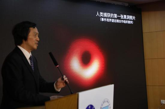 Shen Zhiqiang, head of Shanghai Astronomical Observatory (SAO), presides over a press conference to release the first-ever image of a supermassive black hole at the heart of the distant galaxy M87, in east China's Shanghai, April 10, 2019.. (Xinhua/Fang Zhe)