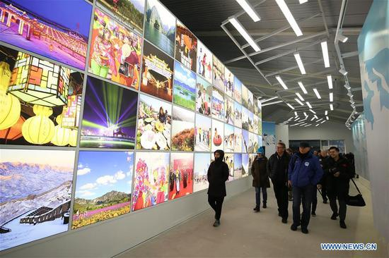 Photo taken on April 9, 2019 shows representatives from major world news agencies at the Yanqing Exhibition Center during a venue tour prior to the Beijing 2022 Olympic and Paralympic Winter Games World Agnecy Meeting in Beijing, capital of China. Representatives from major world news agencies are visiting Beijing for a first look at some of the facilities to be used at the 2022 Winter Olympic Games. (Xinhua/Xu Zijian)