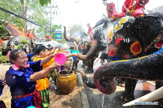 Elephants spray water on tourists during a celebration for the upcoming Songkran festival, Thailand's traditional New Year Festival, in Ayutthaya, Thailand, April 11, 2019. (Xinhua/Rachen Sageamsak)