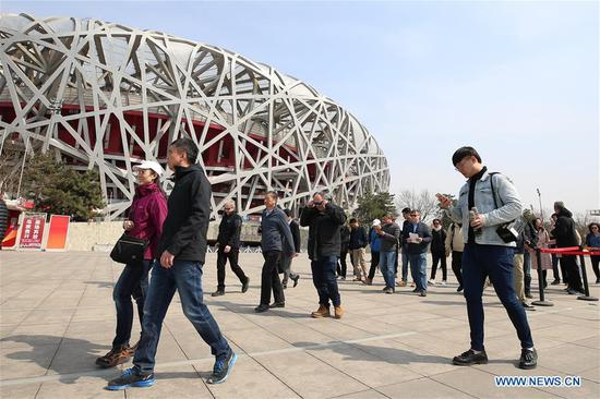 Photo taken on April 8, 2019 shows representatives from major world news agencies in the Natioanl Stadium during a venue tour prior to the Beijing 2022 Olympic and Paralympic Winter Games World Agnecy Meeting in Beijing, capital of China. Representatives from major world news agencies are visiting Beijing for a first look at some of the facilities to be used at the 2022 Winter Olympic Games. (Xinhua/Xu Zijian)