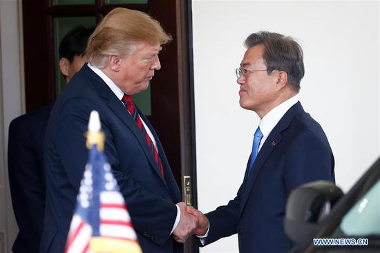 U.S. President Donald Trump (L, Front) shakes hands with South Korean President Moon Jae-in during their meeting at the White House in Washington D.C., the United States, on April 11, 2019. Trump said on Thursday that it was possible for him to hold a third meeting with the top leader of the Democratic People's Republic of Korea (DPRK), Kim Jong Un. Trump made the remarks while speaking to the media together with his South Korean counterpart Moon Jae-in before their bilateral meeting at the White House. (Xinhua/Ting Shen)